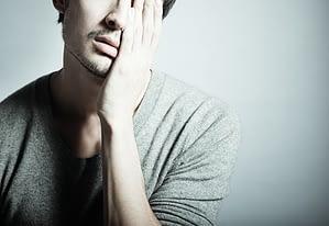 Tired and sad man experiencing amphetamine withdrawal symptoms