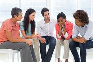 woman talking in co-ed group therapy session at a south florida residential treatment center