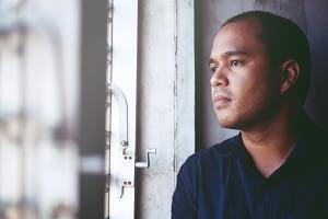 man wonders what is dxm before seeking addiction treatment