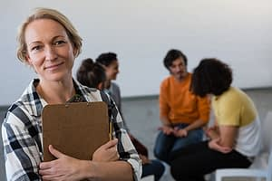 woman leading a group therapy session at a heroin rehab center west palm beach