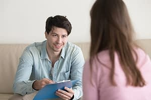 counselor telling client what happens during alcohol detox