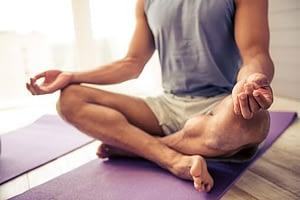Man practicing yoga at inpatient detox