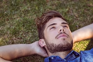 A men's rehab program gives this guy some time to just lay back on the grass and relax.