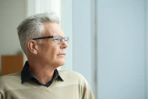 Man looking in the distance wondering about mdma withdrawal timeline for his daughter