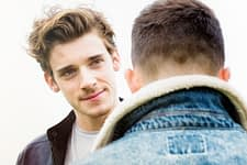 addiction rehab centers - 2 young men talking