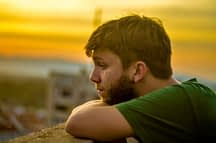 Young man at sunset knowing that cognitive behavioral therapy CBT can change his thinking