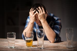 This man who is drinking on xanax shows signs of major depression