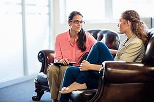 Patient discussing her addiction depression and anxiety with a therapist.