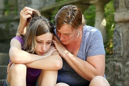 Mother consoling daughter before teen alcohol detox in Florida