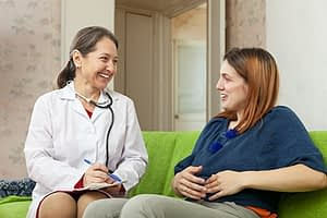 Doctor talking to patient about women's alcohol detox