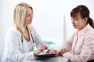 Clinician and patient deciding on medical detox instead of rapid drug detoxification