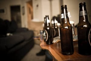 Binge drinking involves lots of alcohol at one sitting-like these beer bottles all lined up.