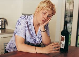 This drunk, sad woman already knows some of the long term effects of alcohol.