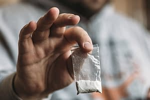 Using the drug in this little baggie can lead to cocaine overdose symptoms.