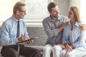 couple discusses talk therapy program with therapist