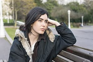 The symptoms of alcohol abuse should lead sad girl on park bench right to detox.