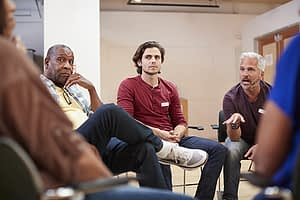 men in group therapy during polysubstance abuse treatment