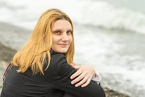 Woman on beach knows she's got a grasp on help for addiction