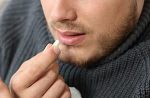 Guy taking a pill doesn't have to ask what is fentanyl.