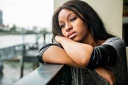 girl is sad after having psychological dependence on drugs