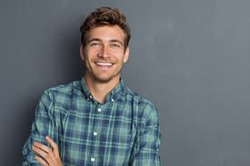 happy man in plaid shirt learned Coping Skills For Lifetime Sobriety
