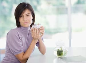 alcohol detox protocol - woman in lavender sweater at table