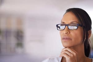 Michigan alcohol detox centers - woman with glasses staring off to the distance
