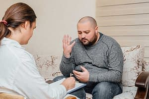 Guy talking to a therapist during individual counseling at rehab