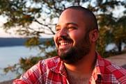 Man smiling after completion of opiate detox program