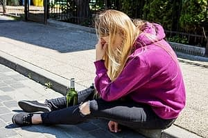 what type of drug is alcohol, this sad girl on the curb is asking
