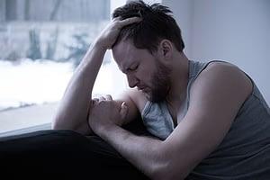 Man despairing as he ponders methadone withdrawal timeline