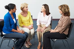 women in group therapy in an inpatient rehab center south florida
