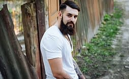 Bearded man against fence looking for marijuana detox center ft lauderdale
