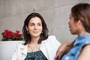 Two women discussing sobriety at a women's detox program