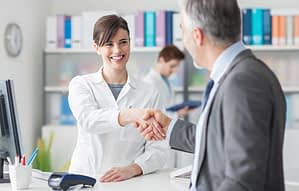 Clinician shaking hands with man after chatting about Florida detox facilities