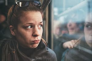 detox facilities - woman looking out train window