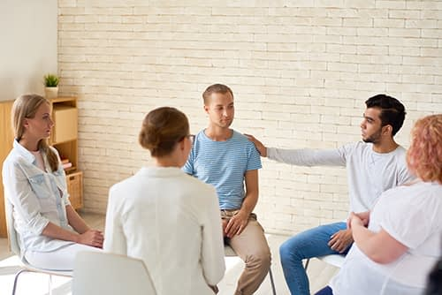 group of people discusses What Is Rehab