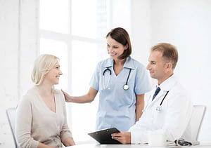 woman talks to doctors about detox programs