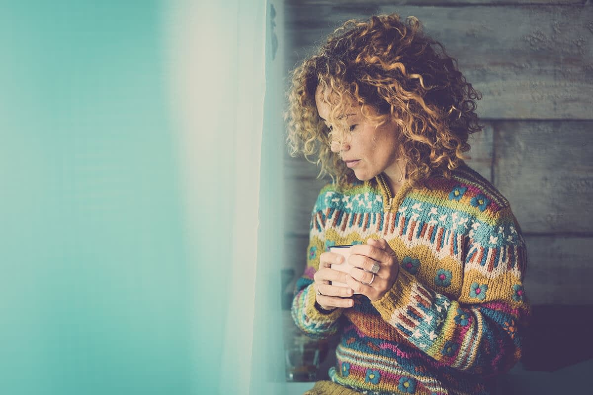woman thinking about what are causes of addiction