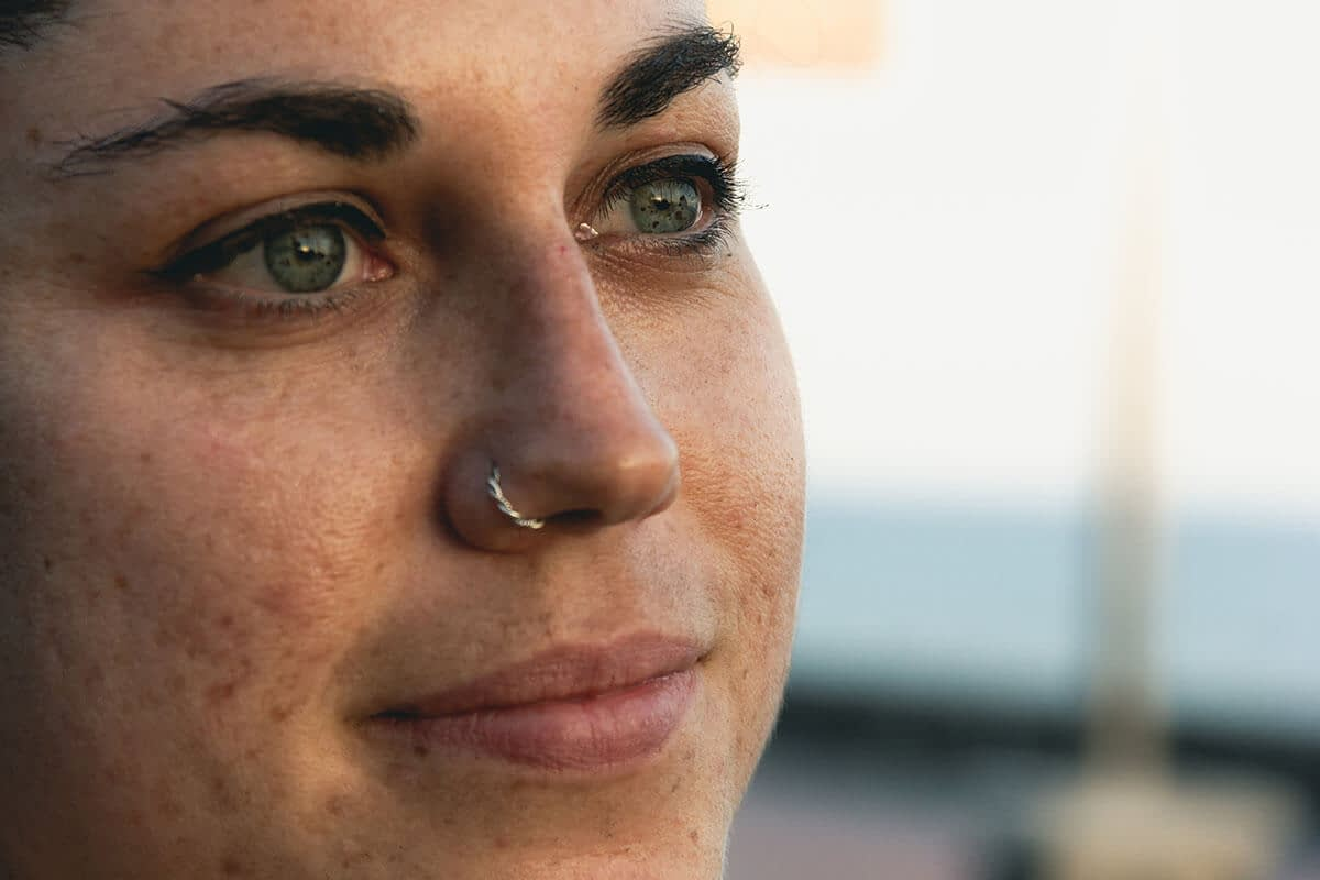 a woman stares into a space and considers substance abuse preventions