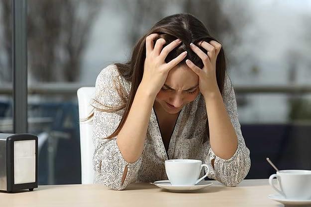 woman drinking coffee has meth withdrawal symptoms