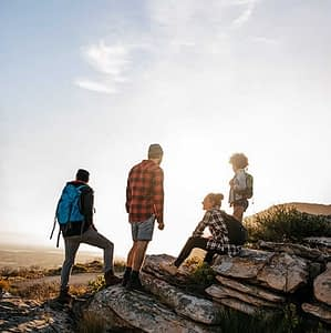 A group of young adults on a hiking trip as a form of adventure therapy