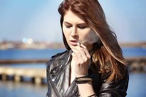 smoking woman has substance dependence problem