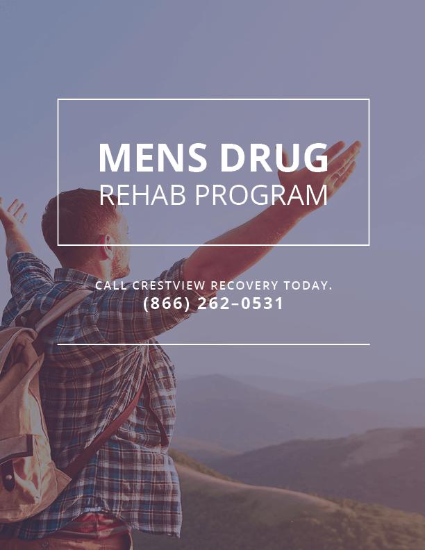 a man raises his hands to the sky at a men's drug rehab program
