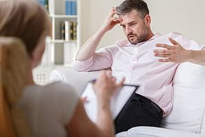man discusses Suboxone Treatment with therapist