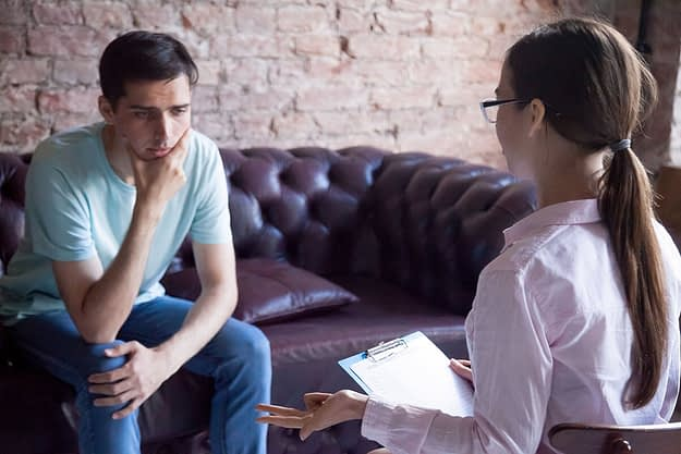 man discussing addiction stigmas with a professional