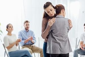 a woman hugs another woman at a heroin rehab center near Tualatin