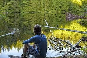 man sitting by the lake at a drug rehab center near Bellingham, Washington