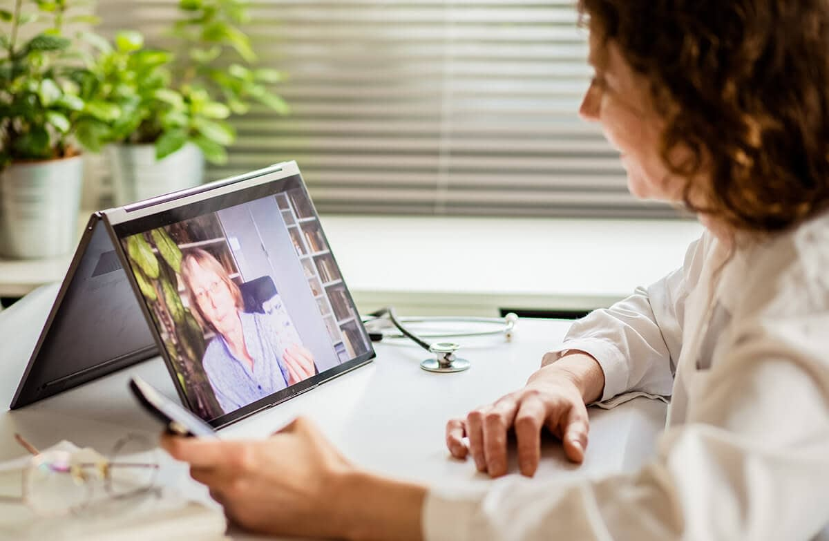 woman learning how a telehealth treatment program can benefit you