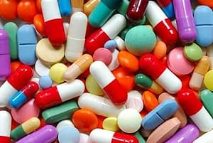 A pile of brightly colored pills that are all synthetic drugs